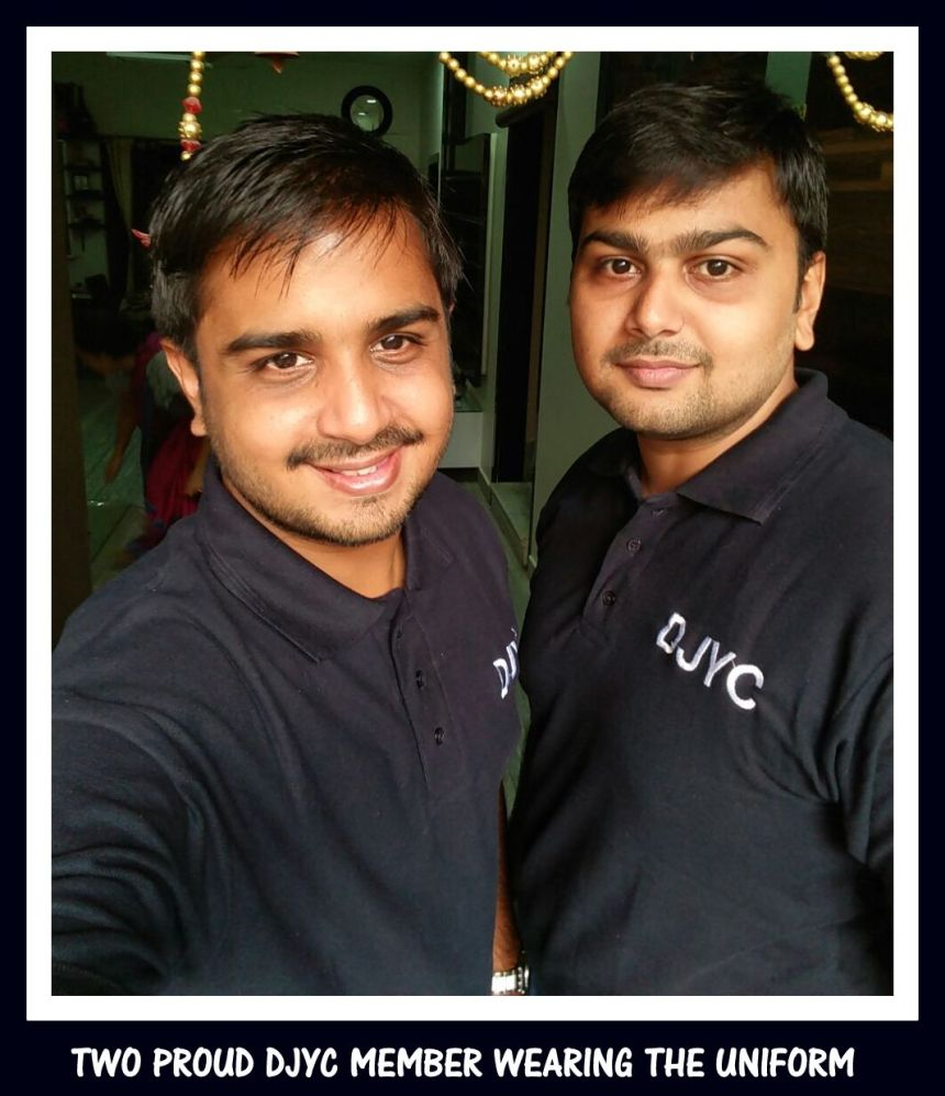 Proud Digamber Jain Youth Club members wearing the uniforms